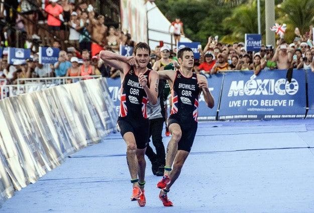 The moment Olympic triathlon champion Alistair Brownlee sacrificed his own chances of winning a race to help his brother – who was about to collapse – across the line.