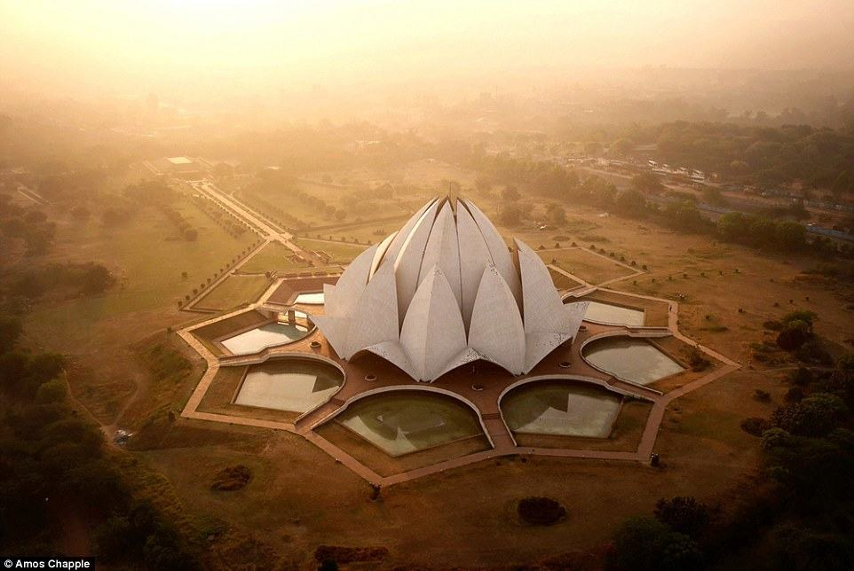 The Lotus Temple, as captured by @amos.chapple. Designed by an Iranian exile, the building serves as the centre of the Bahai