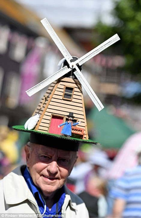 Windmill owner Windy Miller sits atop of this man