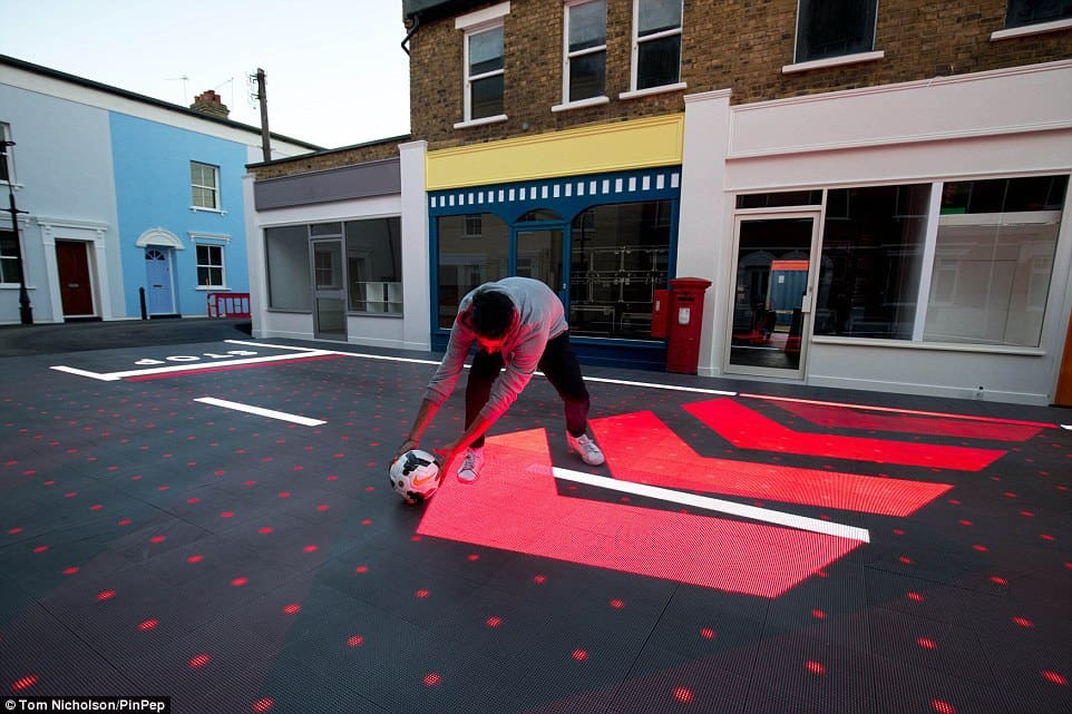 The system can detect when something unusual is happening, such as a child chasing a football into the road. The red chevrons suggest to road users where the child may enter the road and