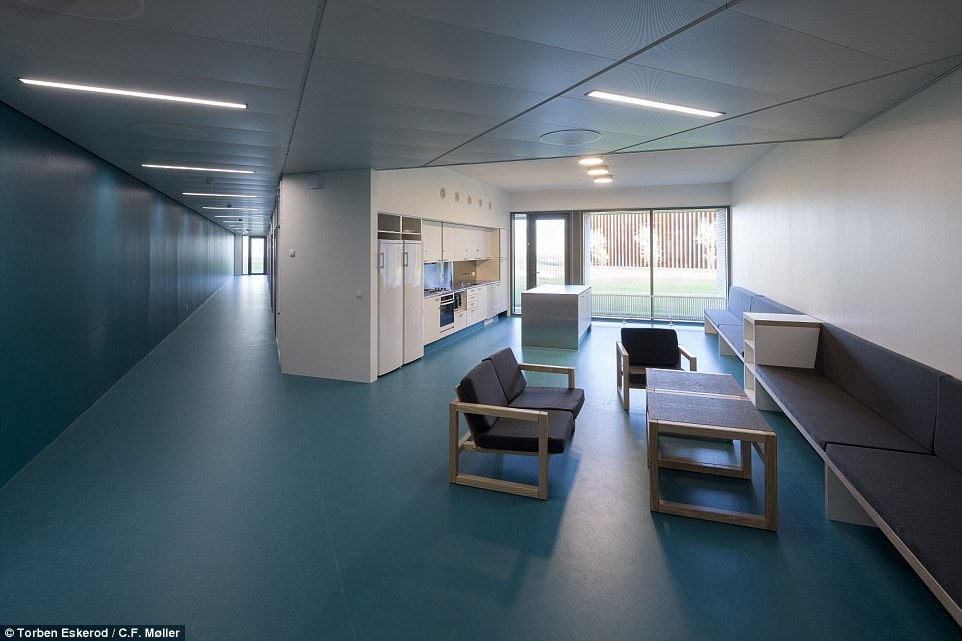 The intention of the designers is to give the prisoners - most of whom are locked up for violent crime - as much of a normal, free life as possible in a bid to accustom them to life on the outside. Pictured: One of the spacious common rooms