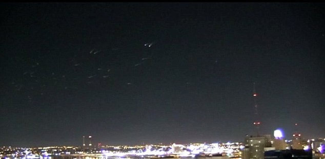 The footage was captured around 4.43am above downtown Milwaukee