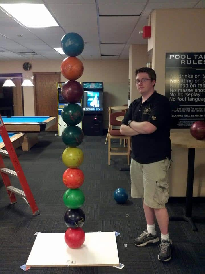 I see some talented stuff here on Imgur... Here are some bowling balls I stacked