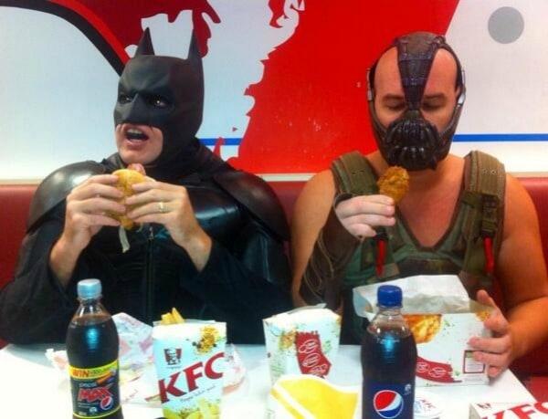 Bane and Batman sharing a meal