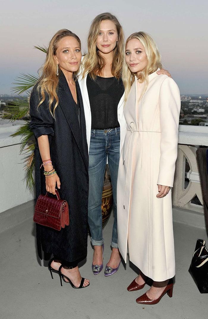 Мэри-Кейт и Эшли Олсен со своей младшей сестрой Элизабет