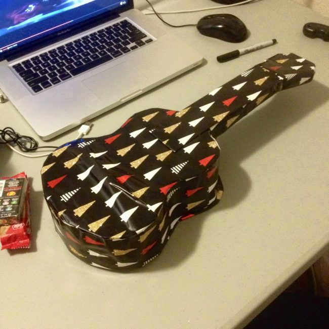Some people are so creative. I can hardly wrap a simple box, while this person made a couple of t-shirts and some soap look like a guitar.