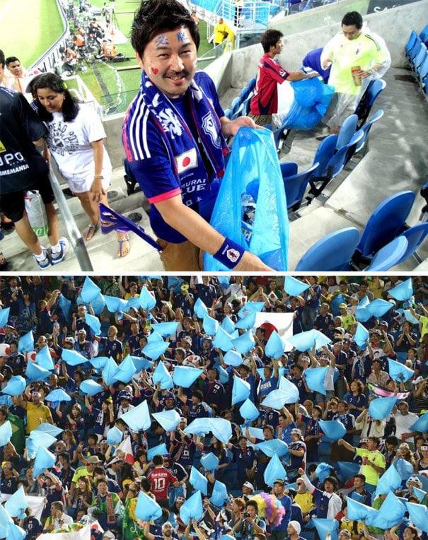 Японские болельщики остались после матча чемпионата мира по футболу 2014 года, чтобы помочь очистить