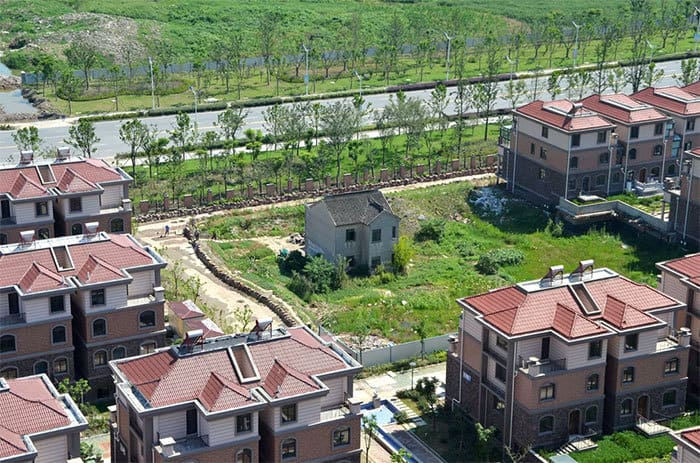 A Lone Resident Holds Out Against Luxury Villas In Suzhou, Jiangsu Province, In July 2013