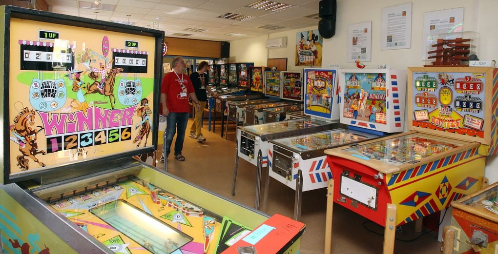 "A 1972 Williams ""Winner"" pinball machine (L) is displayed in Guenter ""Pindigi"" Freinberger"