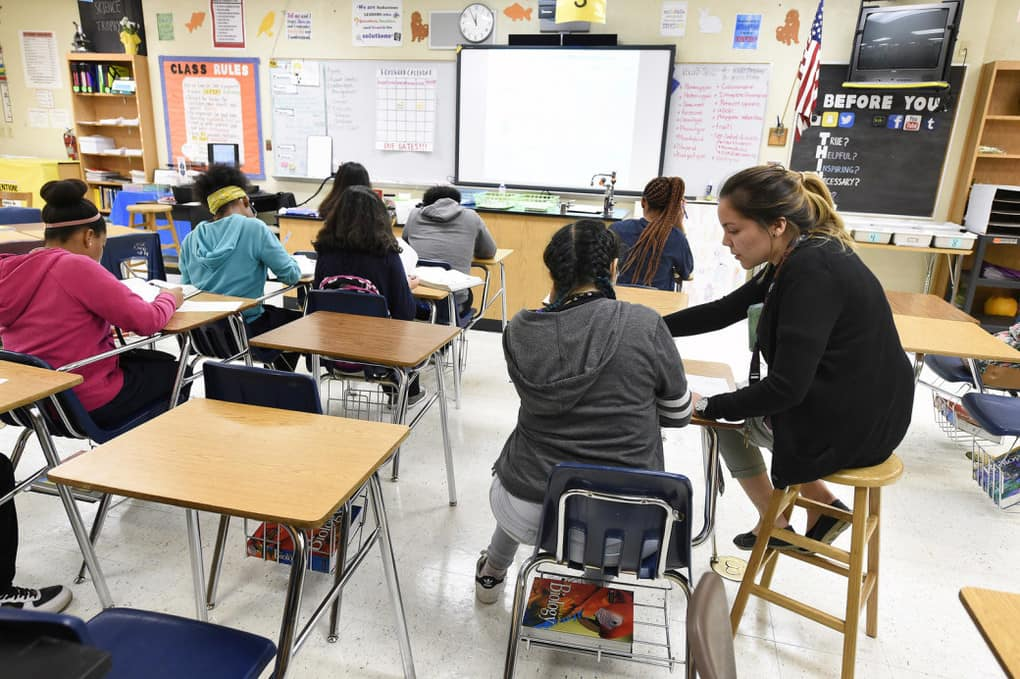 Science teacher Virginia Escobar-Cheng works with students in a high school classroom in Homestead, Florida, on March 10.