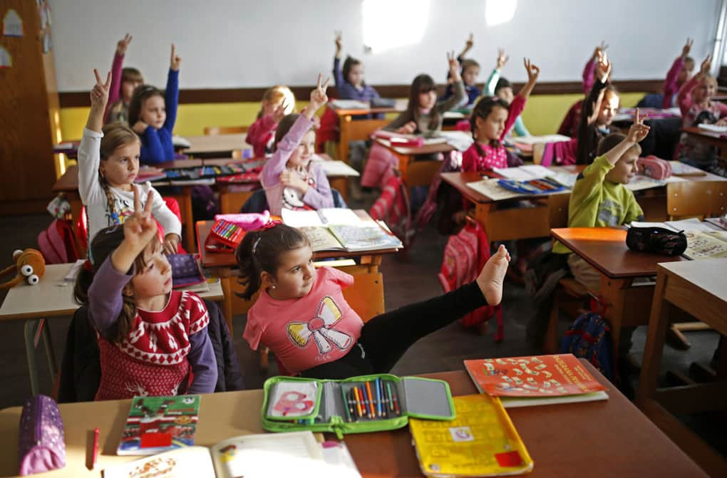 Ramela Meseljevic, a 7-year-old girl born without both of her hands and one of her legs shorter than the other, attends classes in Begov Han, Bosnia, on Dec. 2, 2015.