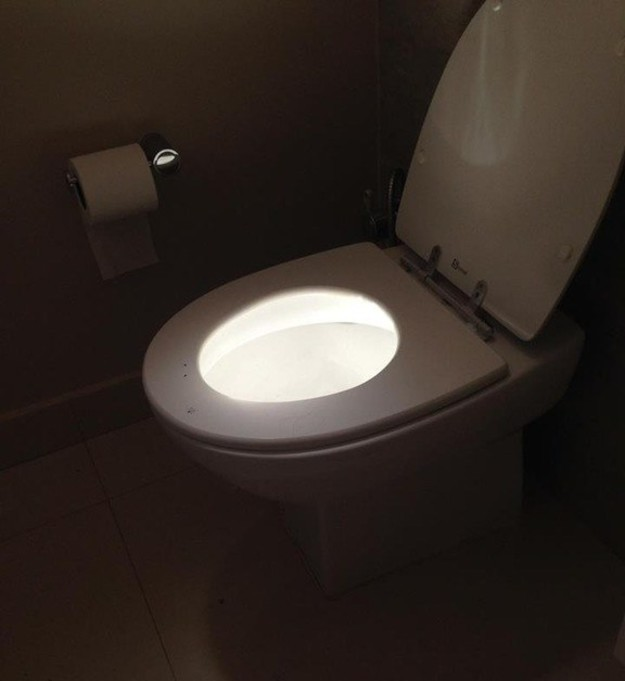 The sun hitting the inside of this toilet bowl with precision.