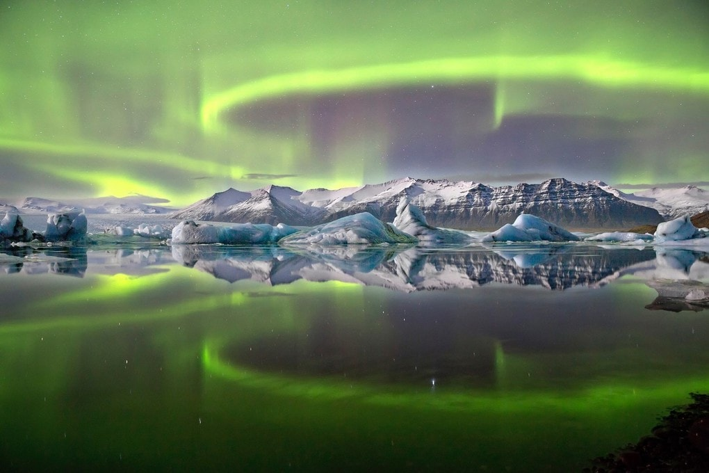 The northern lights over Jökulsárlón, a glacial lake on the edge of the Vatnajökull Glacier. One of the shortlisted images in the Royal Photographic Society