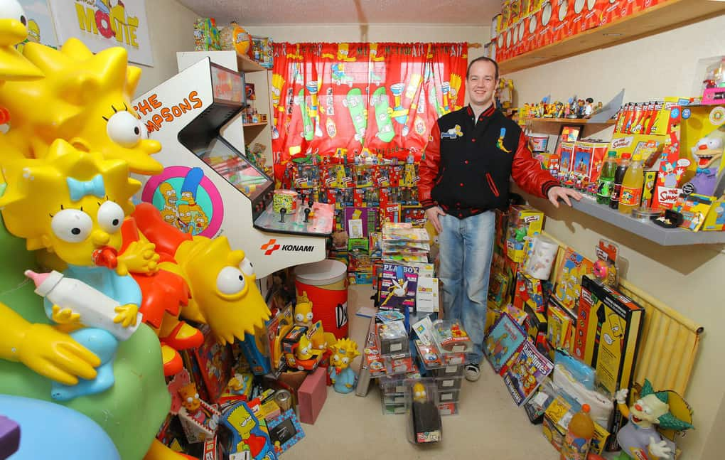 Superfan Glyn Stott of Merthyr Tydfil, Wales, poses with his enormous collection of Simpsons memorabilia. In 2010, Scott attempted to break a world record by watching all 150 hours of every Simpsons episode consecutively.