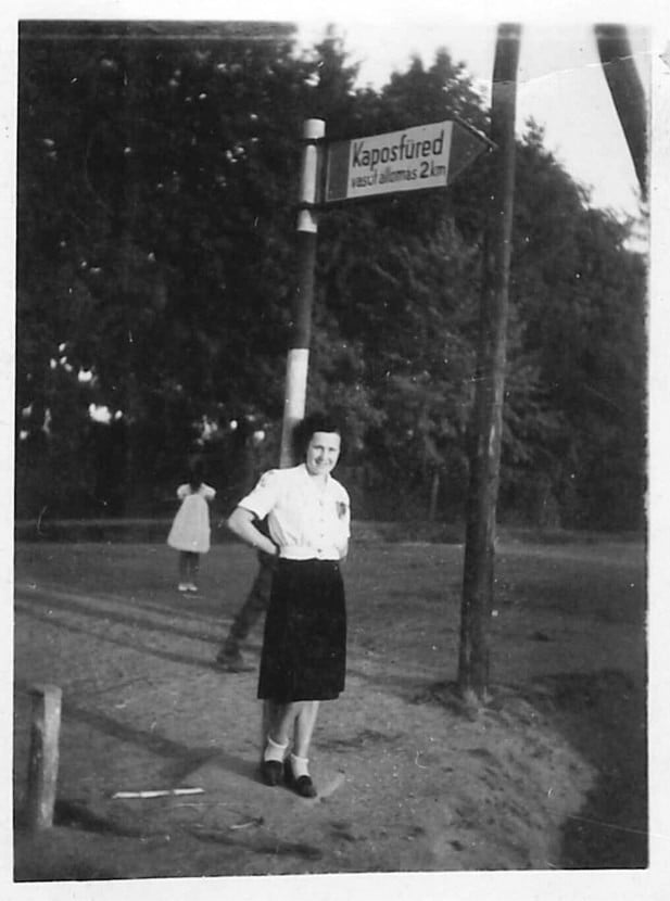 """""""The photograph was taken in 1943 in Kaposfüred, Hungary. My mother is in the foreground, the photo taken by my father. A little girl standing in the background, has no arms, no face. It's like a ghost or a demon. I have the original photograph at home."""" – Szigeti Gyöngyi via paranormal360.co.uk"""