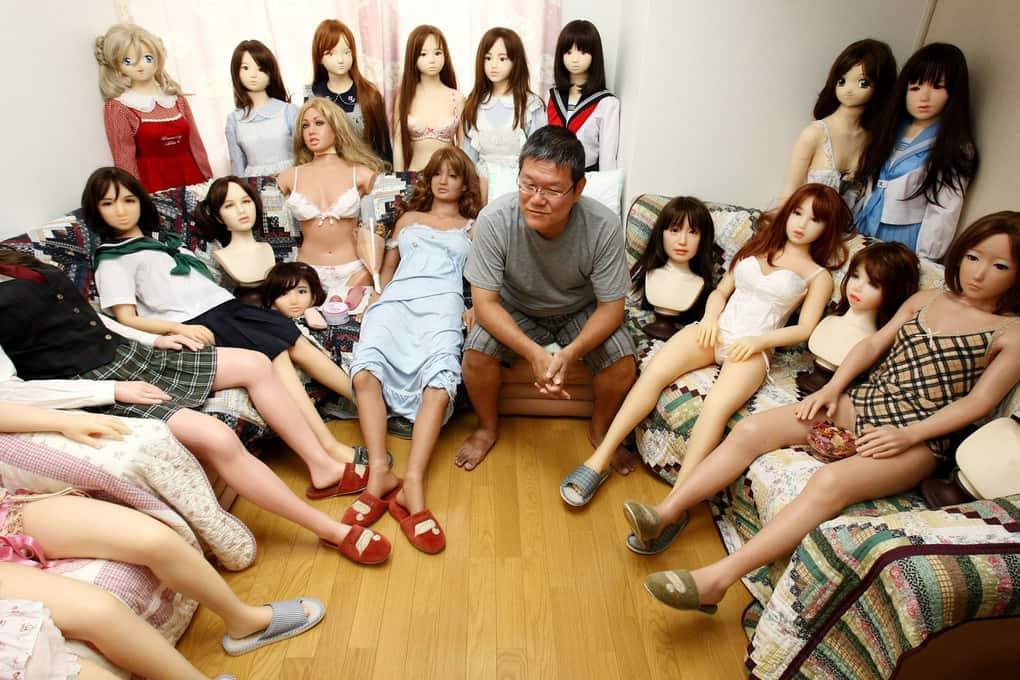 Ta-bo, an avid Love Doll collector, sits with his collection in Tokyo, Japan. The 50-year-old Japanese engineer who rents a special three-bedroom apartment for his Love Dolls, says he owns more than one hundred, which is, to his mind, the world