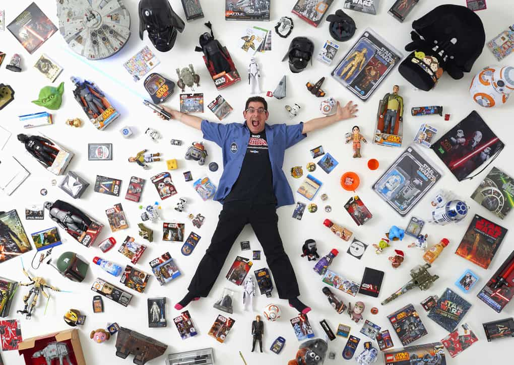 "Star Wars collector James Burns, 44, poses with some of his collection in London. He said, ""I've met so many wonderful people, all over the world. It's a wonderful community of likeminded people with an interest in Star Wars. There's nothing else like it."""