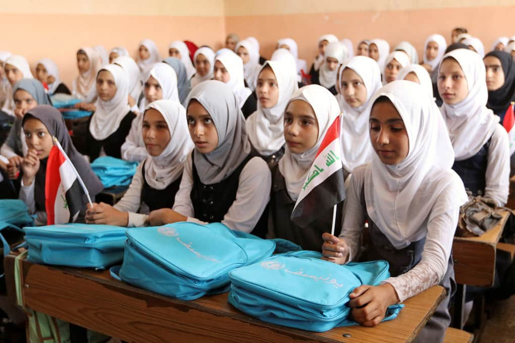 Iraqi girls attend class at a school in Mosul on July 18.
