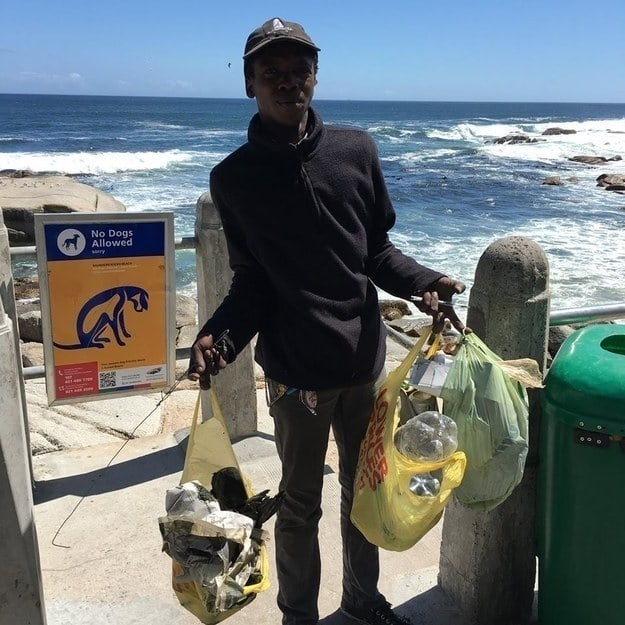 This photo of a 28-year-old homeless man in Cape Town who picks up litter from the beach every day, without pay, because he wants it to look nice for the tourists.