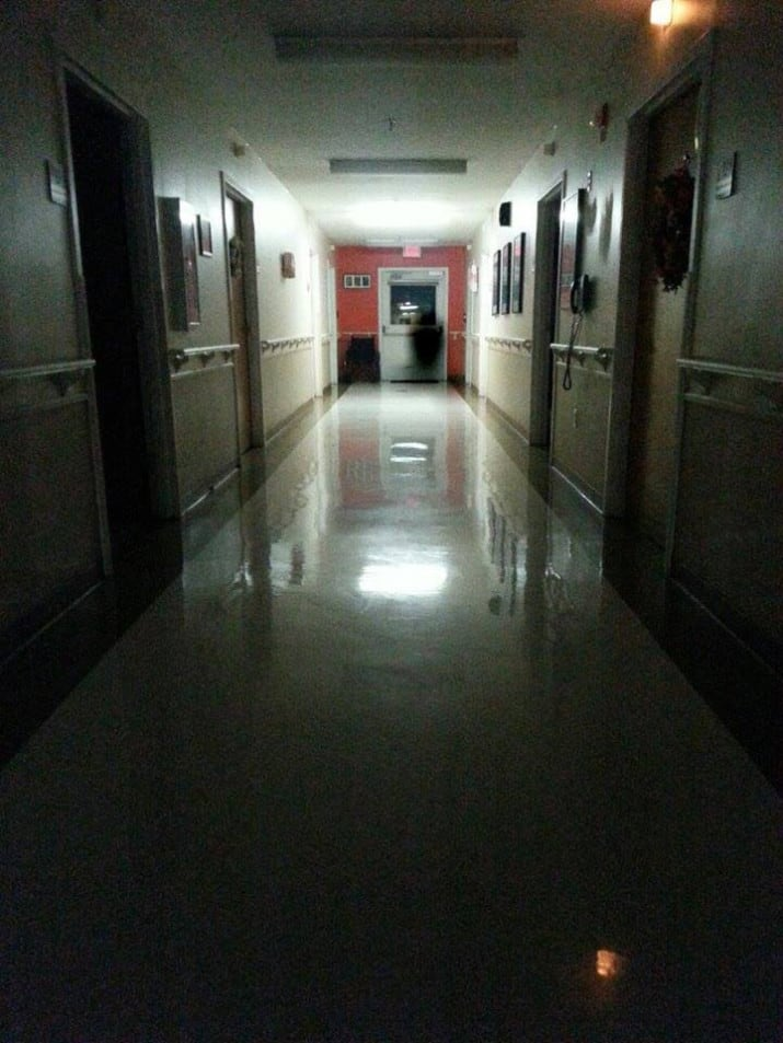 """""""This photo was taken by a resident of the nursing home that my mom works in. Prior to the photo being taken, members of the staff and other residents heard the sounds of a door opening and closing along with the appearance of a call light turning on and off, yet nobody was in the room. From what I have been told this picture had been taken roughly 15 minutes after a patient in the facility had passed on. Is it possible this is the person? Or perhaps"""