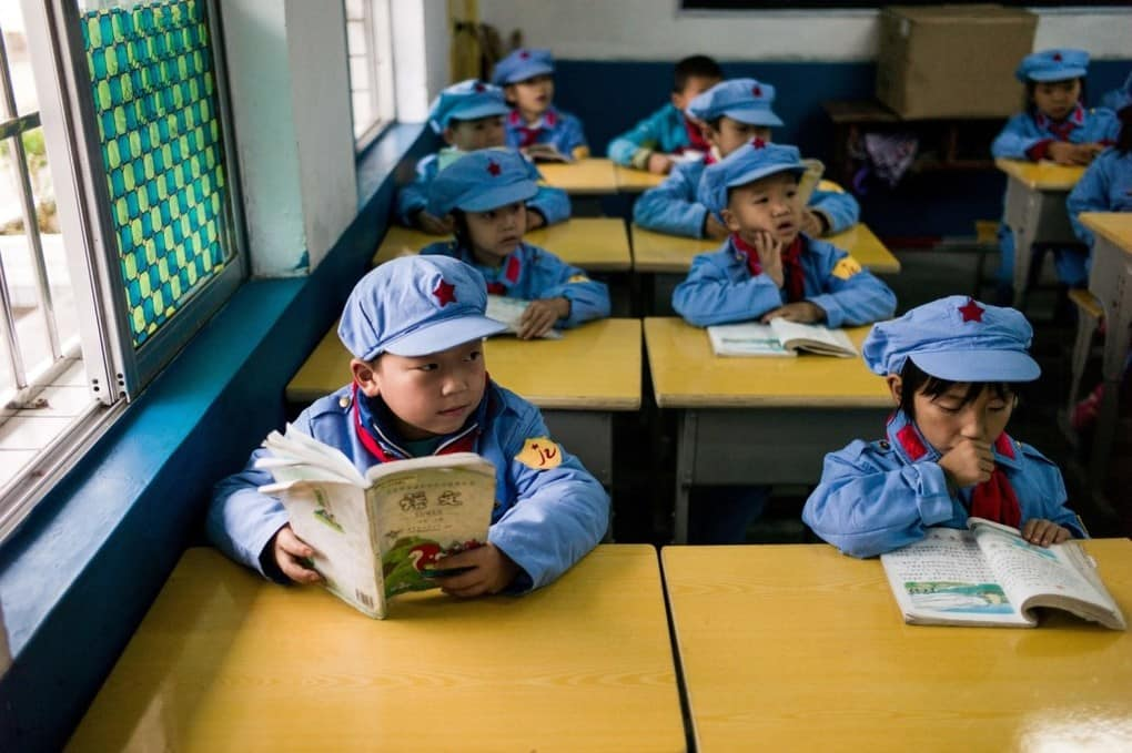 "Students read in the Yang Dezhi ""Red Army"" elementary school in Wenshui, China, on Nov. 7."