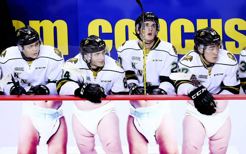 Nicolas Mattinen #3, JJ Piccinich #84, Daniel Bernhardt #20 and Kole Sherwood #67 of the London Knights watch from the bench during an OHL game against the Niagara IceDogs at the Meridian Centre in St Catharines, Ontario, Canada.