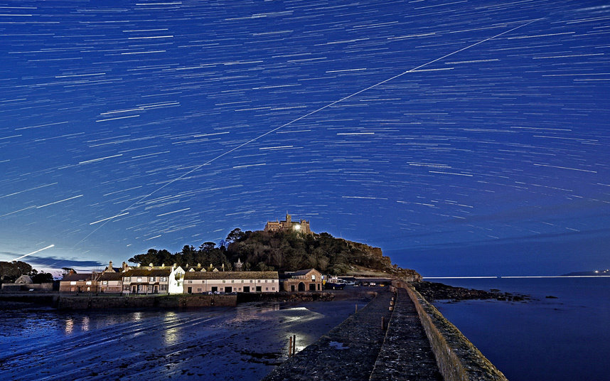 The passage of the International Space Station has been caught on camera as it orbits over Cornwall's St Michael's Mount. The image was taken by photographer Alan James just before dawn on Wednesday 20th January.