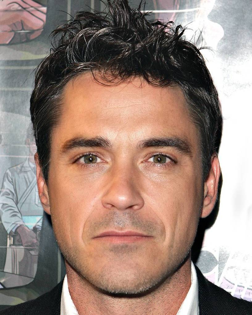 Robert Downey Jr. mixed with Robbie Williams