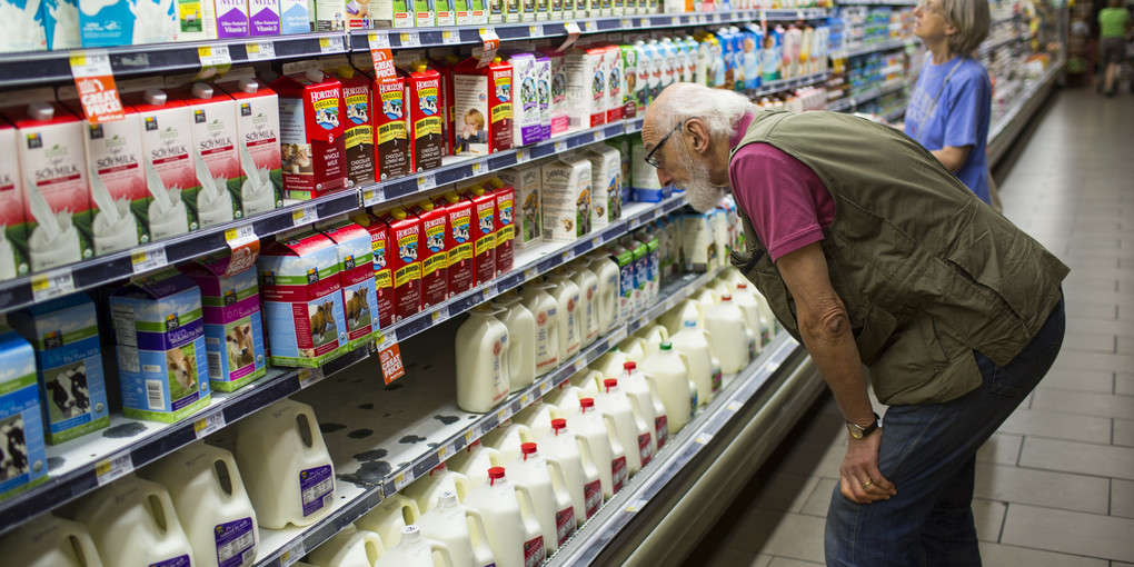 Customers Search For Milk Products At Whole Foods In Washington, DC